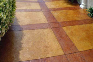 This picture shows concrete staining in Seattle. Orange and brown/red colors with pattern and design.