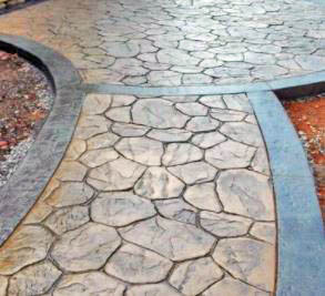 This picture shows a stamped concrete path in Seattle. The size or the concrete varies and it creates beautiful shape and design