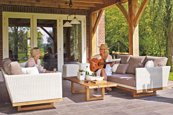 This picture shows a covered concrete patio builder. People are enjoying this patio which is made out of concrete