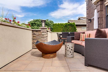 This picture shows patio contractors in Seattle. Beautiful patio with furniture.