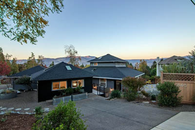 this picture shows beautiful concrete driveways in Seattle leading to a home