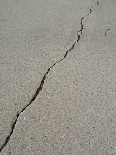 this picture shows a concrete crack needing a concrete repair in Seattle